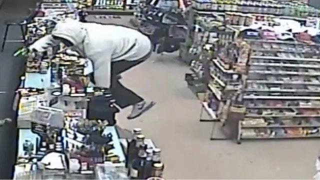 Armed robber with gun picture