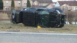 Canton police officer hospitalized after rollover crash