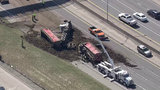 Truck spills load across northbound I-75 near 8 Mile Road