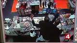 Video: Robber holds employee at gunpoint while stealing money from Detroit store