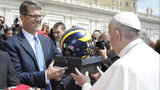 Michigan football coach Jim Harbaugh gives Pope Francis a gift