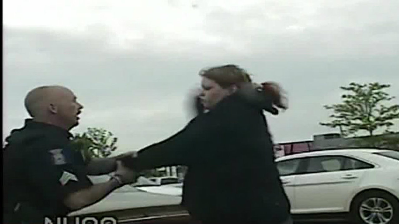 Woman Caught On Dashcam Sucker Punching Officer
