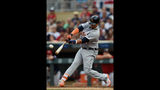Martinez goes deep twice, Tigers top Twins 6-3