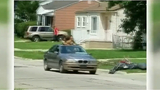Video shows young children riding on top of car on Detroit's west side