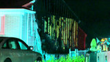 RV catches fire, damages 2 homes on Angling Street in Livonia