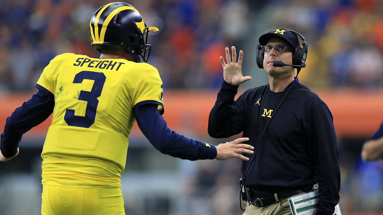Michigan Topples Cincinnati 36-14 After Late Surge