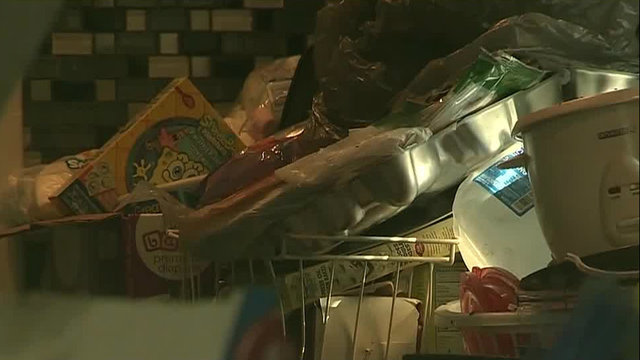 Trash piled in kitchen of filthy house on Detroit's west side