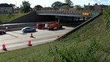 Oversized dump truck damages overpass on I-75 in Southwest Detroit