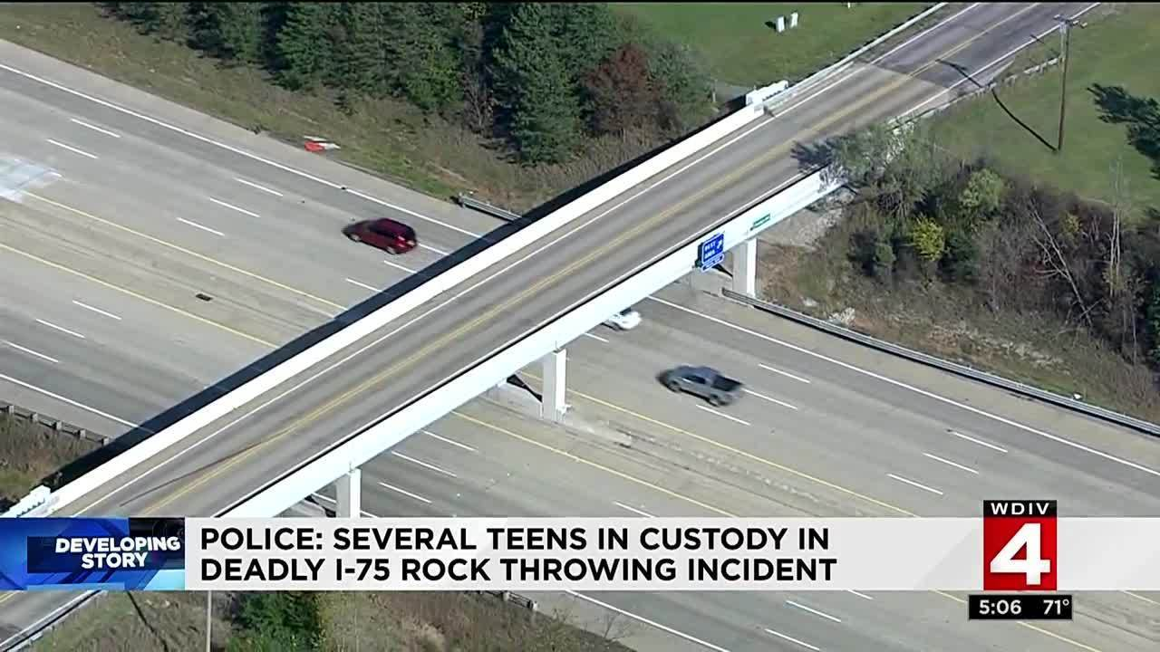 authorities several teens in custody after rock thrown from