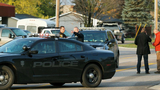 Michigan police officer charged with firing gun into car in which woman hurt