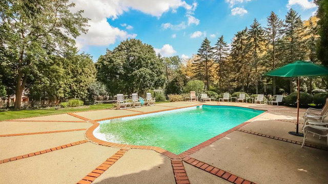 Ann Arbor Hills colonial with pool overlooking pristine grounds asks $1.3M