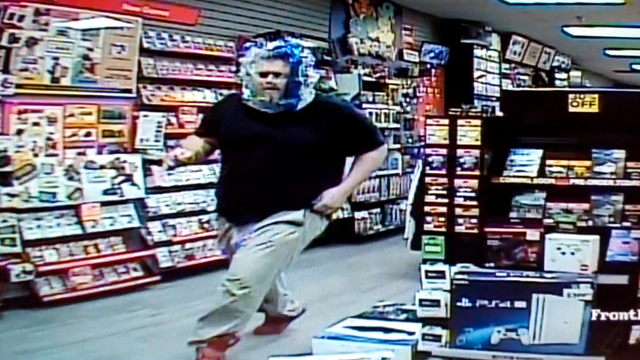 gamestop burglar attempts to disguise himself with see through