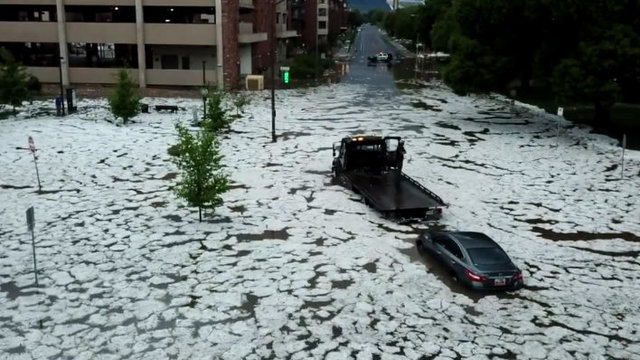Aerial video shows rain, hail flooding Colorado street, swamping cars