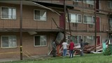 Apartment building condemned after walkway collapses