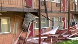 Detroit apartment complex condemned after walkway collapses, injuring two