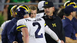 Michigan slips to No. 21, Michigan State to No. 15 in latest AP poll