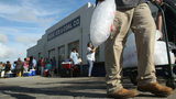 Florence: Hundreds line up for free supplies in isolated Wilmington