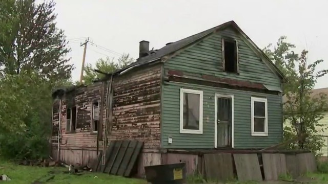 Firefighter injured falling through floor of Detroit house after double…