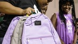 Company giving away bags to children living in Flint