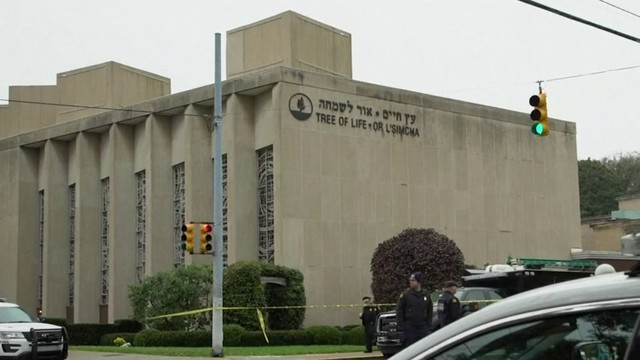 Pittsburgh copes with tragedy as accused synagogue gunman appears in court