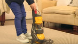 This toy Dyson vacuum for kids also cleans floors