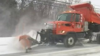 Oakland County crews working to clear roads of snow after storm