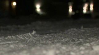 Oakland County crews work to clear neighborhood streets of snow