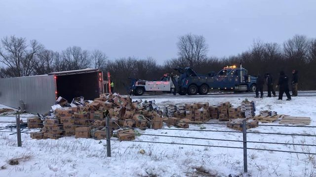 Produce truck rolls over on US-23 in Monroe County