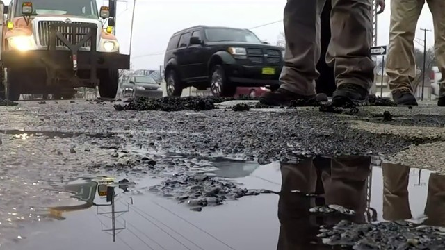 Michigan governor unveils plan to fix crumbling roads