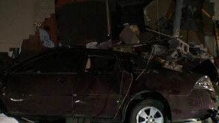 Car crashes through side of building in Dearborn Heights
