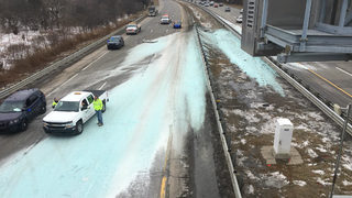 Troy police: 50 tons of rock salt spilled on freeway after truck crashes