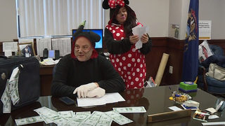 Michigan official dresses as Mickey to criticize government spending