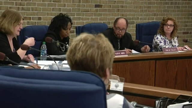 Romulus city employees pack City Hall to fight rising health care costs