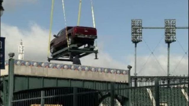 WATCH LIVE: Vehicles being lifted onto center field fountain at Comerica Park