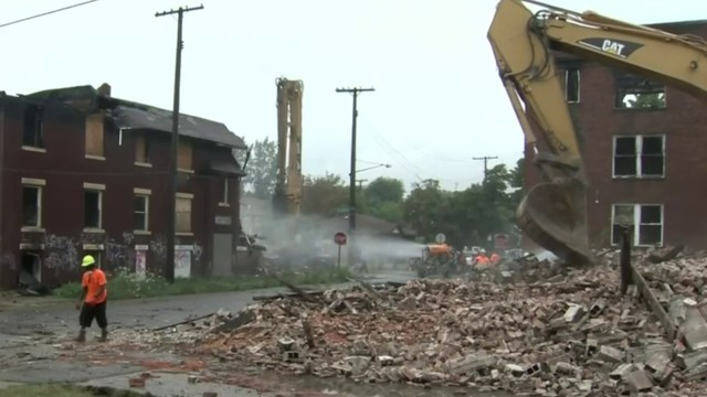2 charged with accepting bribes in Detroit demolition probe