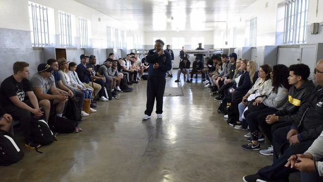 Michigan football team visits prison Mandela spent 18 years in South Africa