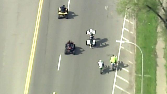 ATV, dirt bike riders pop wheelies during rush hour traffic on Detroit's&hellip&#x3b;