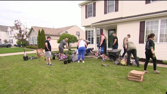 Organization surprises Macomb County widow of veteran with yard makeover