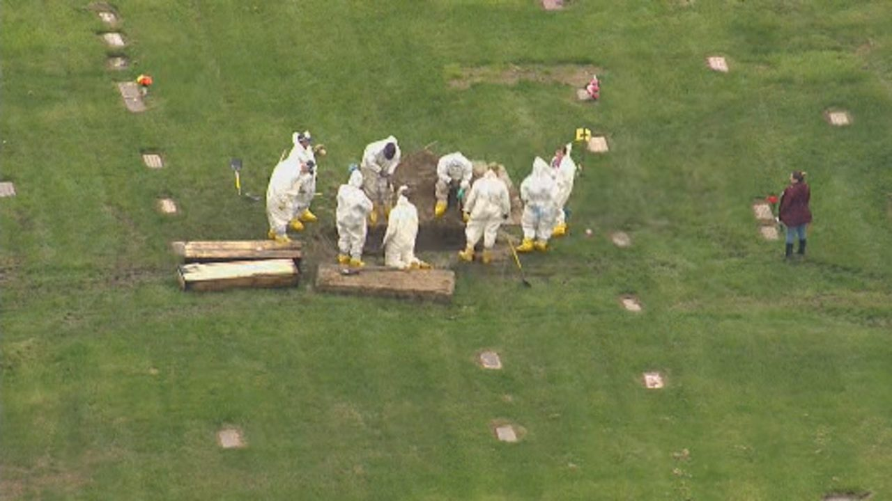 Officials dig up Canton Township graves as part of Detroit missing person's cases