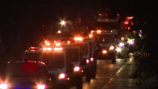 Tow truck drivers gather en masse to honor driver killed last May in I-94 crash
