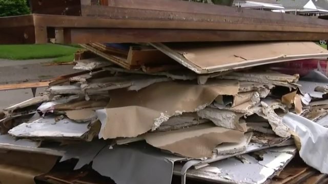 Allen Park residents fed up with piles of trash from flooding in front of homes