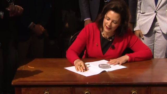 Whitmer signs bipartisan Michigan auto insurance bill on Mackinac Island