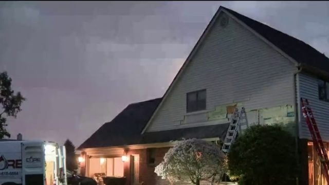 Crews work on Shelby Township house struck by lightning