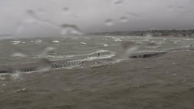 South Haven pier engulfed by water amid high winds, lake levels