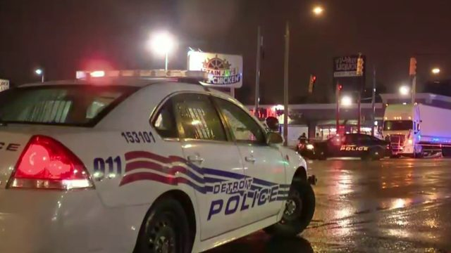 Vehicle pinned under semi truck in horrific Detroit crash that killed 2 men