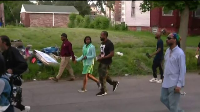 Activists walk through Detroit neighborhoods to promote peace on 'No…