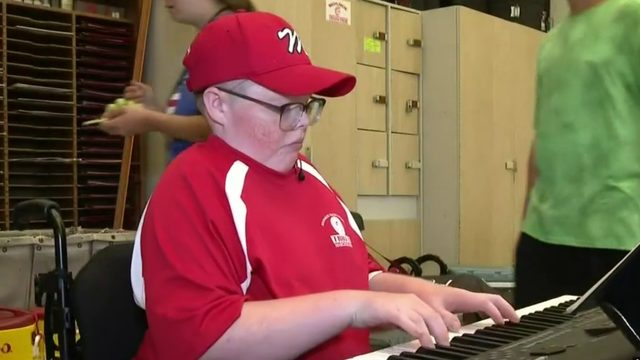 Monroe High marching band raising money so more can play