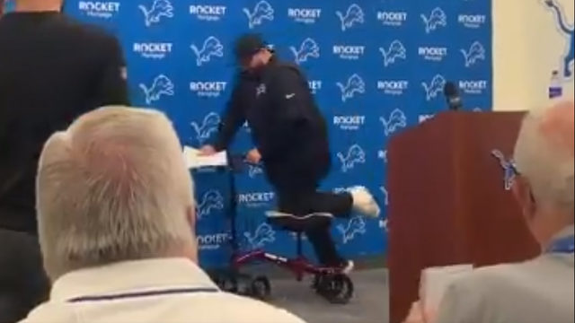 Detroit Lions head coach Matt Patricia arrives at training camp with leg in cast