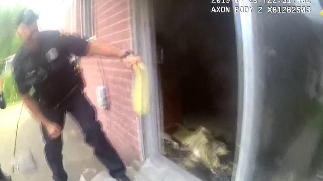 Footage shows Westland police pull 79-year-old woman from burning home