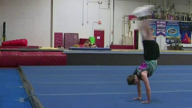 Teen boy in Metro Detroit works to bust stereotypes in cheerleading